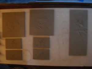 Fireplace tiles cut to size allowing for clay shrinkage and set to dry on drywall